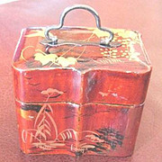 Vantine's  decorated red lacquer perfume caddy with two empty bottles inside