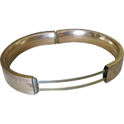 S L & I Gold plated bangle bracelet signed and dated Sept 12,1911 decorated with flowers