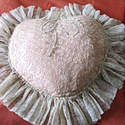 Vintage heart shaped lace and satin boudoir pillow trimmed in French lingerie flowers
