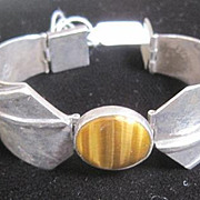Mexican sterling bracelet centered by oval tiger's eye polished stone