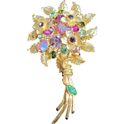 Costume jewelry bouquet of flowers  pin with multi colored rhinestones and filagree back