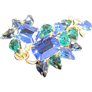 Abstract blue and green rhinestone pin with unfoiled rhinestones