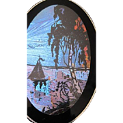 Vintage Assemblage art of a sail boat in an evening sky using bright blue butterfly wings in the background