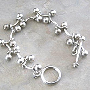 Sterling curved bumbell and ball link bracelet with toggle and bar closure stamped 925