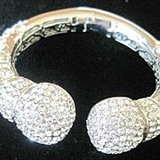 Vintage rhodium plated clamper style bracelet by Joan Boyce set with many brilliant rhinestones