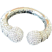 Vintage rhodium plated clamper style bracelet by Joan Boyce set with many brilliant rhinestones