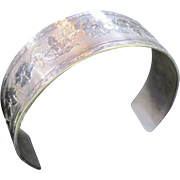 Artist signed Estate engraved sterling floral cuff bracelet with two diamonds by Hugo Kohl
