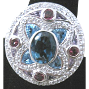 Sterling Ring with elaborate multi colored topaz in various sizes shapes colors