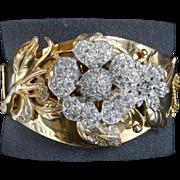Wonderful gold plate bangle bracelet with raised rhinestone floral decoration