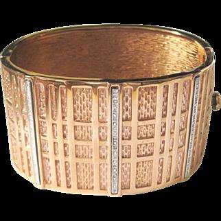 Gold washed steel bangle bracelet with diamond bars set in sterling