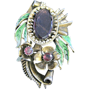 Vintage Reinad large floral pin with enameled leaves and large purple rhinestone flower