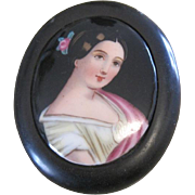 Victorian Handpainted pin a portrait of a young Victoria with sterling silver clasp