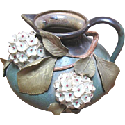 Stellmacher Amphora pottery pitcher made with applied floral and leaf trim