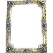 Brass filagree table top picture frame with jeweled decor and self standing easel back