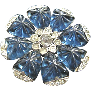 Vintage rhodium plated flower pin with carved blue glass petals and rhinestone trim