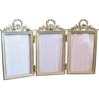 French bronze Dore triple picture frame with foliate decor and back easel