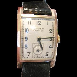 Vinage Mans'  working Gruen curvex watch in 14k yellow gold with black lizard band