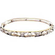 Vintage signed 14kyg bangle style diamond and natural pearl bracelet