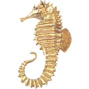 Vintage 1960's Sea Horse pin in stamped 18k yellow gold with a ruby eye