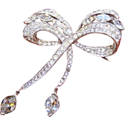 Marcel Boucher MB signed rhinestone bow pin with dangle marquise at the bottom