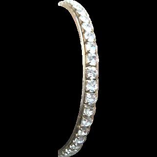 Rhinestone studded gold plated bangle bracelet