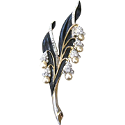 Early Trifari snow flower pin with black enamel rhinestones and faux pearls