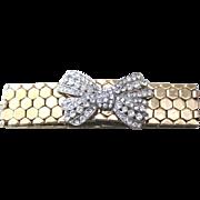 Snake skin bracelet gold plated base metal flexible with rhinestone bow decoration