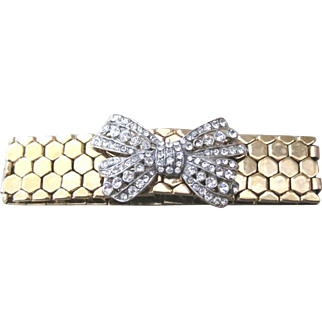Snake skin bracelet gold plated base metal flexible with rhinestone bow decoration