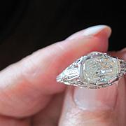Vintage Platinum diamond ring containing .77 carat. unusual hand cut oval diamond
