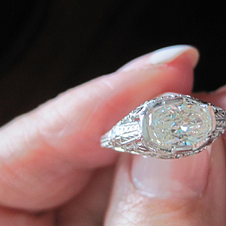 Vintage Platinum diamond ring containing .77 carat. unusual hand cut oval diamond