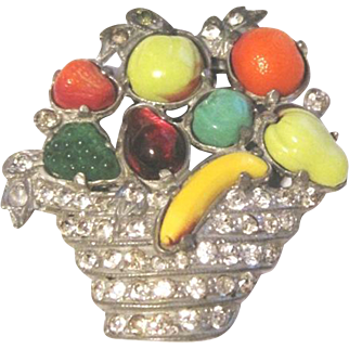 Vintage Art Deco dress clip with carved glass fruit in a rhinestone basket