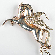 Gold plate applied over sterling Pegasus flying horse pin trimmed with rhinestones