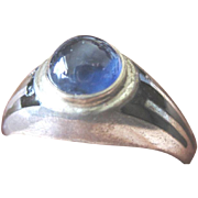 Art Deco Man's ring sterling with enameled sides and set with a blue sapphire cabochon