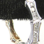 Bamboo shaped two color 14k yellow and white gold hoop earrings set with 0.46 tw diamonds 5.76 grams