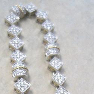 LovelyLadies' 18k two tone diamond bracelet 1.75 tw diamonds G-H color 17.6 grams flexible links