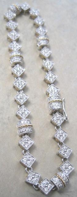 LovelyLadies' 18k two tone diamond bracelet 1.75 tw diamonds G-H color 17.6 grams flexible links