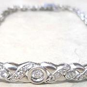 Ladies Platinum diamond chain bracelet. Round brilliant cut  G-H color 0.21 tw G-H color