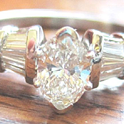 Vintage Platinum engagement ring with marquise shaped 0.60 center and six baguettes 0.32tdw G-H