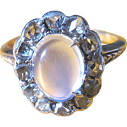 Ladies 14kyg oval rainbow moonstone cab 2.2carats surrounded by 0.36tw European cut old world diamonds
