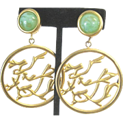 Vintage Karl Lagerfeld couture large gold tone clip earrings with open drop medallion and green glass button tops
