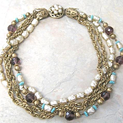 Vintage four strand costume jewelry necklace includes faux pearls chains purple and turquoise glass beads