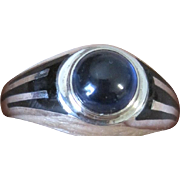 Art Deco period sterling silver ring set with 1.95 cabochon sapphire and decorated with black enamel stripes size 10 1/4