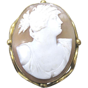 Vintage Carved Italian shell cameo set in gold plated bezel with a pin back