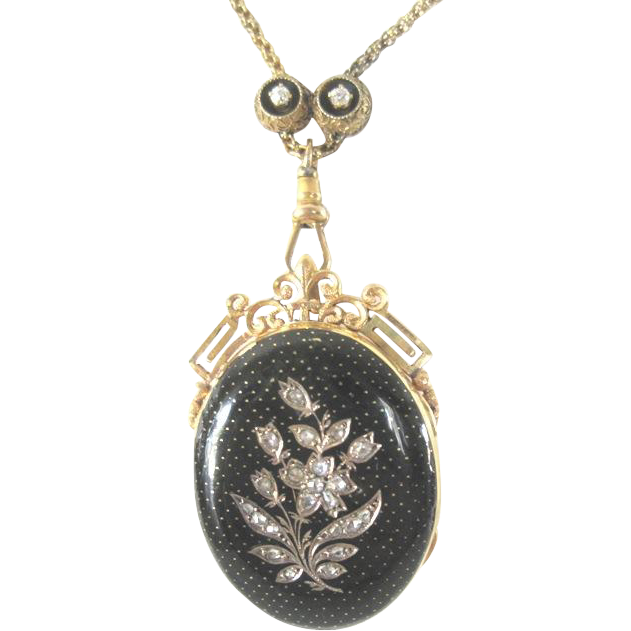 Antique Victorian 14k yellow gold chain and enamel locket decorated floral diamond front and diamond slide.