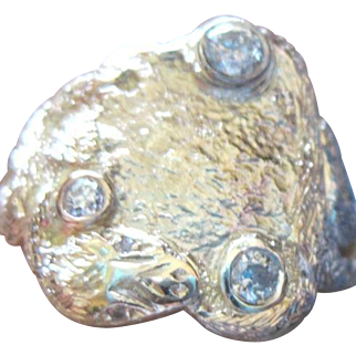 Man's 14kyg diamond custom ring with dragon or snake features size 11 1/4 weighs 7.2 grams