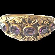Vintage Czech. bangle bracelet with applied flowers and bezel set purple crystals