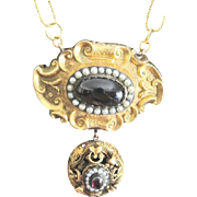 Victorian 14kyg pin made into a dangle necklace set with oval garnets and natural seed pearl trim 26.3 grams