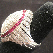 Vintage Ladies 18k white gold cocktail ring containing 2.65 carat natural rubies and 2.60 tw G-H VS-VS1 diamonds