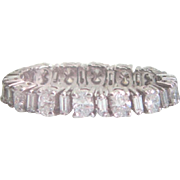 Flexible eternity band of 1.50 tw set in platinum containing oval and baguette diamonds VS1-VVS