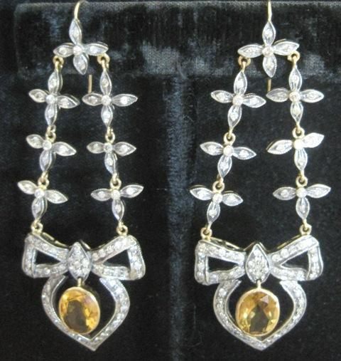 Pair of Edwardian era sterling silver and 15kyg suspended diamond earrings with bows and dangle citrines